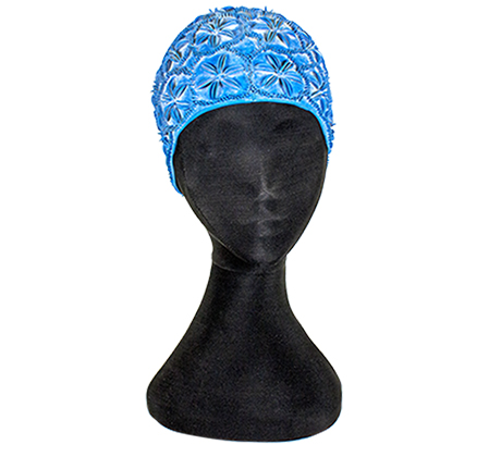 Light blue rubber bathing cap shaped to cover the ears and back of the head, with flowers in relief pattern over the surface.