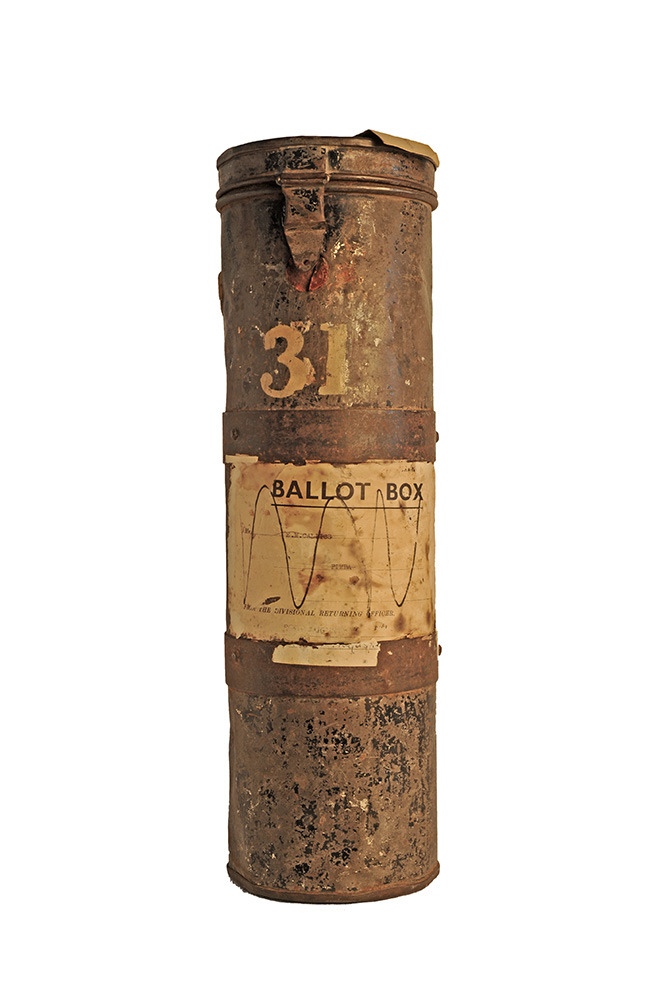 Leather tube with white stickers and the number '31' attached to the outside