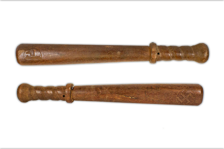 Two sides of a wooden baton shaped object carved with a swastika and Italian Fascist symbol.