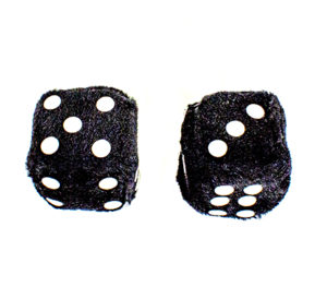 Two black fluffy dice with white spots showing numbers five and three.
